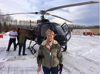 Connie moore in front of helicopter in Canada